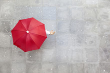 Man Holding A Red Umbrella