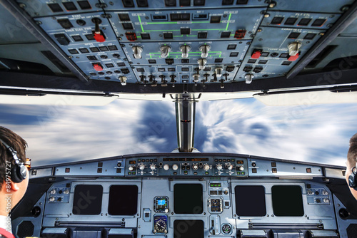 Photo  plane cockpit and cloudy sky