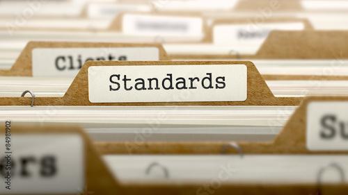 Cuadros en Lienzo Standards Concept with Word on Folder.