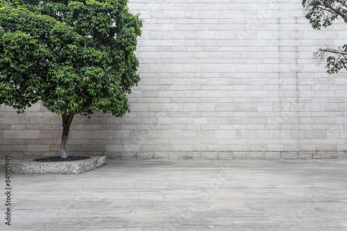 Foto op Plexiglas Wand white brick wall and empty sandstone road