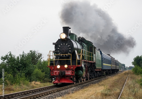 Aluminium Prints Bestsellers Old steam locomotive travels by rail