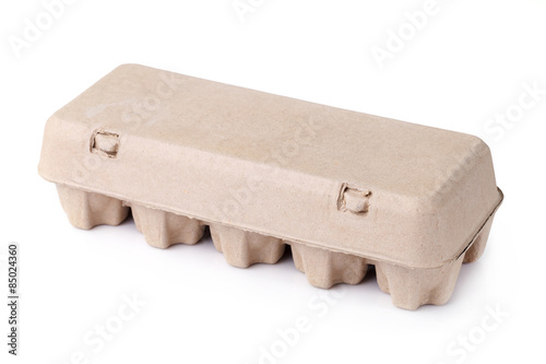 eggs in an egg carton on a white background