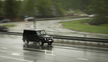 Black SUV Travels Fast On The Highway.