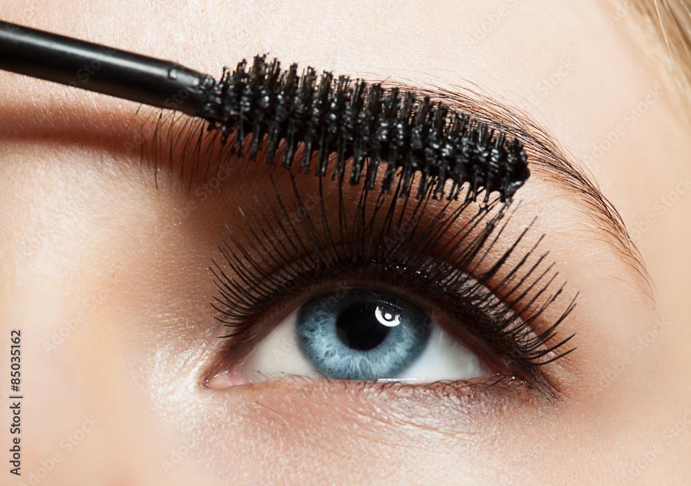 Valokuva  Close-up of blue eye with long lashes with mascara