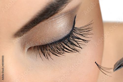 Fotografiet Makeup close-up. Eyebrow makeup. Eyelash extension.