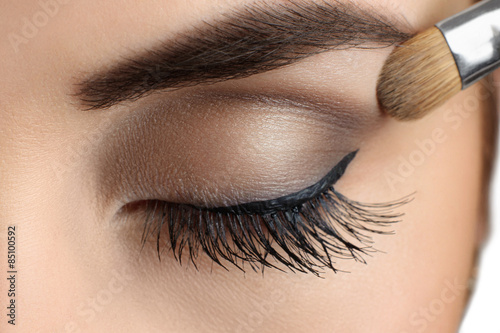 Makeup close-up. Eyebrow makeup, brush. Poster