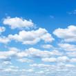 Leinwandbild Motiv many little white clouds in summer blue sky