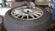 Mechanic in the service repair car wheel