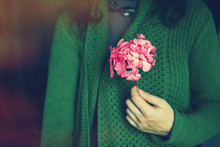 Lady Holding Bunch Of Pink Flo...