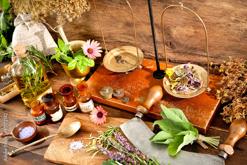 Fotografie, Obraz  Ancient natural medicine, herbal, vials and scale on wooden background