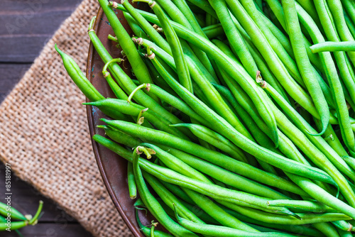 Fotografie, Obraz  Green beans or string beans on rustic wood.