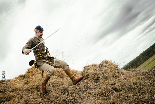 Poster Chasse man in ethnic suit in context of historical reconstruction