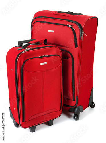 Fotografie, Obraz  Baggage: Red Suitcase And Carry On Isolated on White