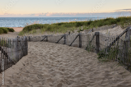 Fotografie, Obraz  Wooden fence with Atlantic ocean early morning near Provincetown in Cape Cod , M