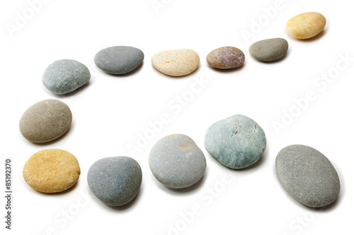 Fotografía  Snaking Line of Twelve Pebbles Steps Isolated