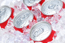 Close Up Of Soda Cans In Ice