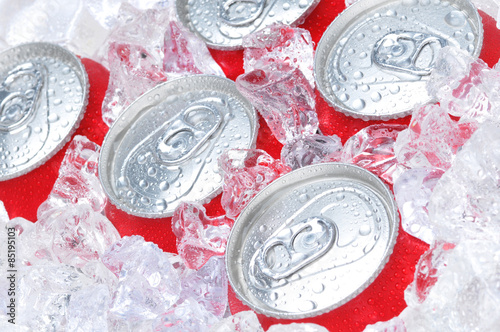 Foto  Close Up of Soda Cans in Ice