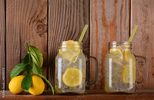 Lemonade Glasses on Shelf with Lemons Canvas Print