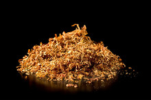 Pile Of Tobacco On A Black Background.