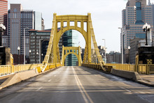 Yellow Sixth Street Bridge - Yellow Painted Iron Bridge And Empty Road Leads Into A City Of Tall Buildings