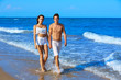 Couple young walking on the beach shore