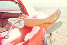 Relaxed Woman Legs In A Car Window On The Beach