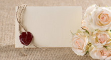 Cream Roses And Postcard With Red Wax Seal