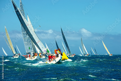 фотография  Sailing yachts regatta. Series yachts and ships