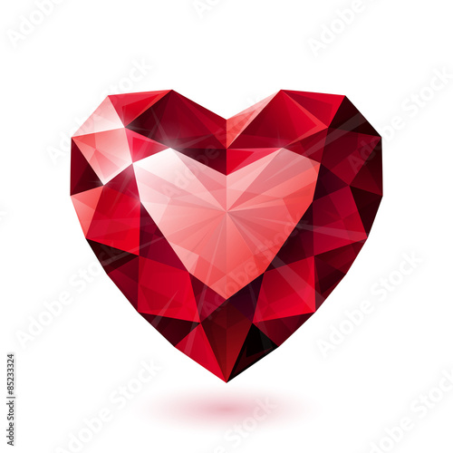 Fotografía  Shiny isolated red ruby heart shape on white background