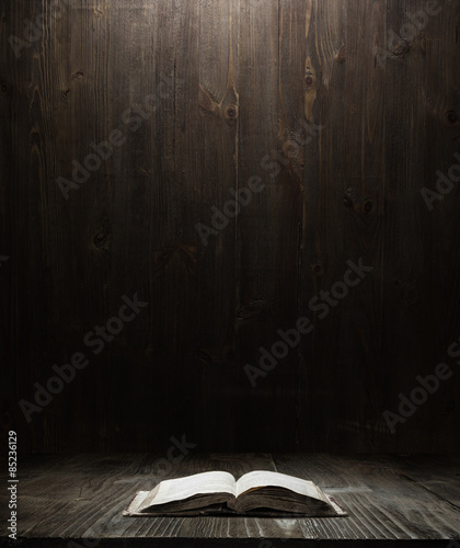 dark wooden background texture. Wood shelf, grunge industrial interior with a book