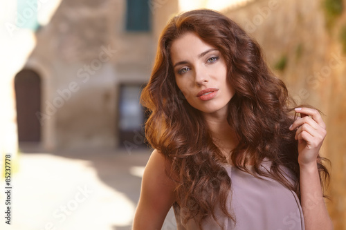 Fototapety, obrazy: Beautiful woman on the streets of the old Italian town