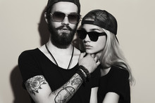 Fashion Beautiful Couple Together.Tattoo Hipster Boy And Girl