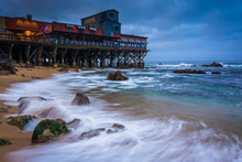 Restaurants And A Rocky Beach At Cannery Row, In Monterey, Calif