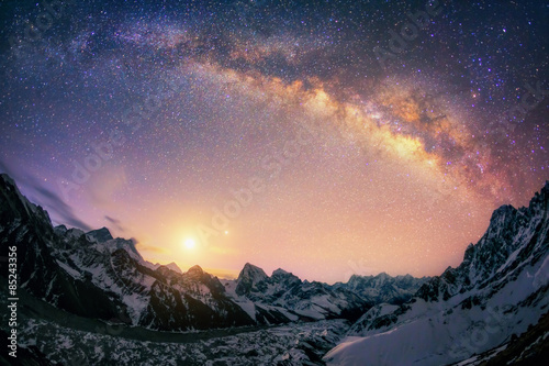 Fotografering  The dome of the Milky Way under the main Himalayan ridge.