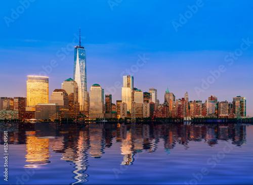 Skyline of Lower Manhattan at night Poster