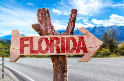 Spoed Foto op Canvas Canada Florida wooden sign with road background