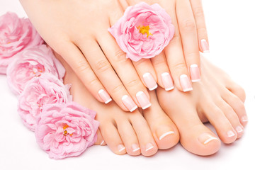 FototapetaRelaxing pedicure and manicure with a pink rose flower