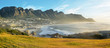 canvas print picture - Camps Bay Beach in Cape Town, South Africa, with the Twelve Apostles in the background.