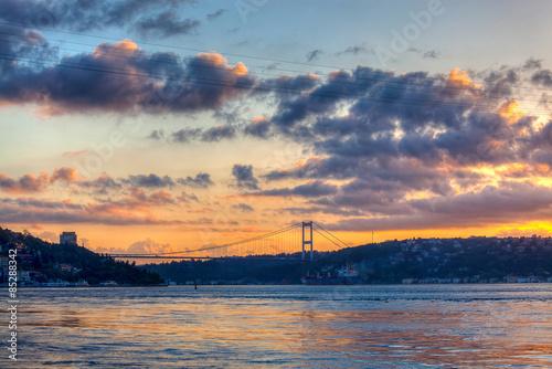 Rumeli Hisari (Rumeli Castle) and Fatih Sultan Mehmet Bridge at dawn Poster