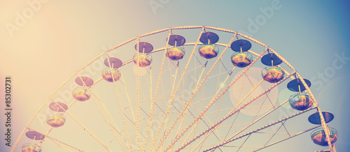 Fotografie, Obraz  Vintage filtered picture of a carousel at sunset.