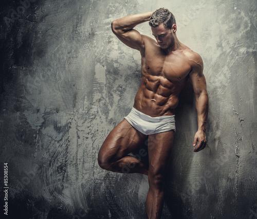Photo  Muscular guy in white panties