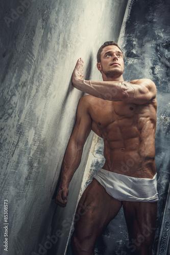 Fototapeta Muscular guy in white panties obraz na płótnie
