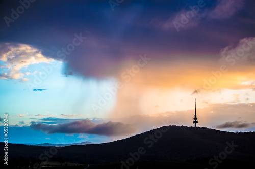 Fotografering  Rain clouds accumulated behind the Black Mountain in Canberra, Australia in the