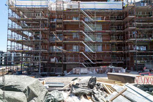 Construction of new apartments with building materials Poster