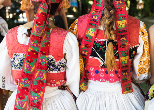 Anonymous girls in folklore costumes, back detail