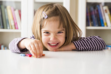 Smiling Little Girl Playing Wi...