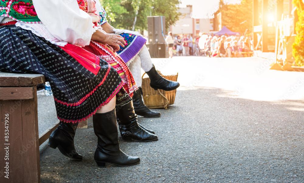 Fototapeta Anonymous senior female friends in folklore costumes