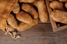Potatoes On Rustic Wood Background