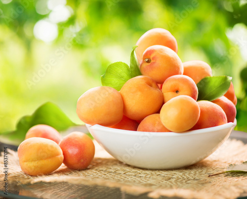 Wallpaper Mural Apricot. Ripe organic apricots on a wooden table