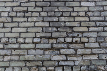 fragment of the old wall masonry with white sand-lime brick